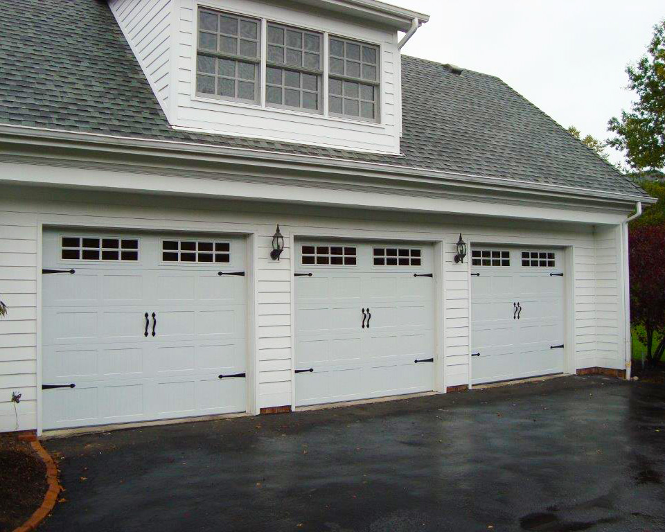 Chi door c h i overhead doors model 5916 long panel in for Fimbel garage door prices